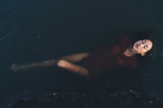 Relaxed lady lying in water