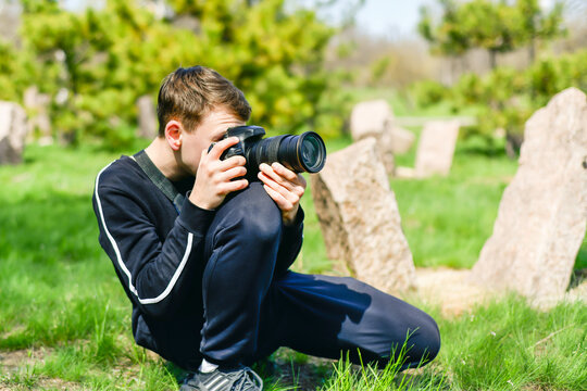 A man looks through the captured images, photographed with a SLR