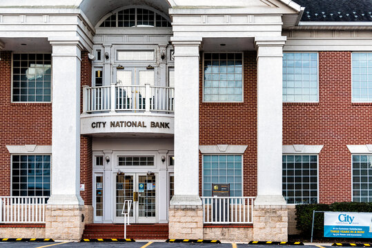 Marlinton, USA - October 7, 2020: Local regional community branch of City National Bank with entrance sign and columns in old town of West Virginia rural countryside town city with brick facade