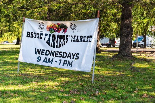 Basye, USA - October 7, 2020: Bryce ski resort parking lot with sign banner for farmers market on Wednesdays selling local fresh organic farm produce in countryside rural Virginia mountain town