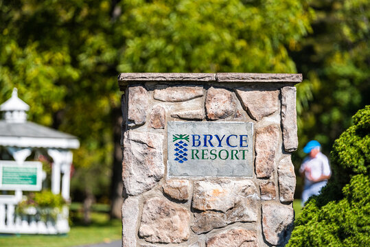 Basye, USA - October 7, 2020: Town in Virginia countryside Shenandoah county with building entrance sign for Bryce resort ski in autumn fall