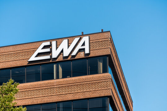 Herndon, USA - October 7, 2020: EWA logo building sign in Northern Virginia for corporate business providing cable internet phone services