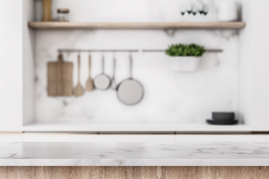 Stylish marble tabletop on wooden platform with copyspace for your logo at blurry kitchen utensils and dishes on light wall background. 3D rendering, mock up