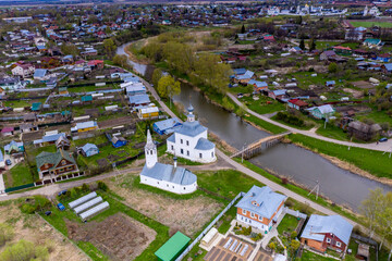 Fototapeta a panoramic view of the historical center of the temples and monasteries of the city of Suzdal in the rain filmed from a drone