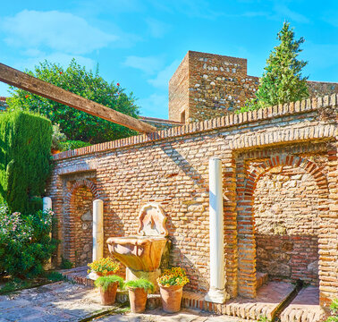 The drinking fountain in Alcazaba garden, Malaga, Spain