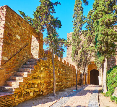 Explore Alcazaba ramparts, Malaga, Spain