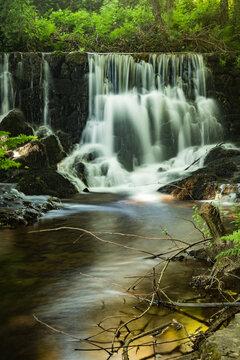 Waterfall near the river beach of Mamoa