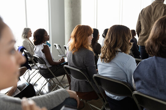 Businesswomen listening in business conference audience