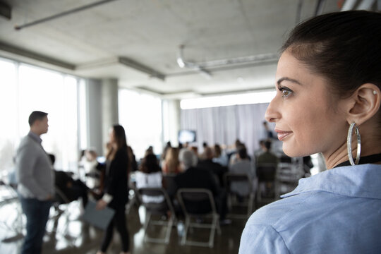 Thoughtful businesswoman at business conference