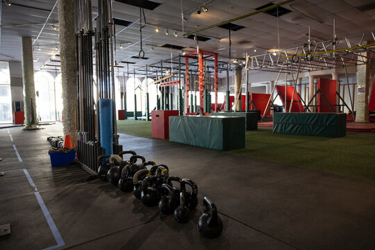 Kettlebells and equipment in empty gym