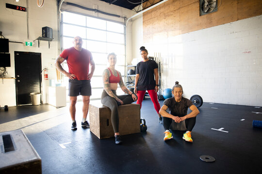 Portrait confident people working out in cross training gym