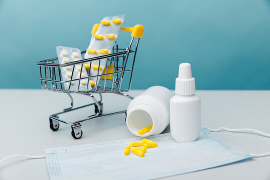 Shopping cart with compounded prescription medications shipped from a mail order pharmacy on a blue background