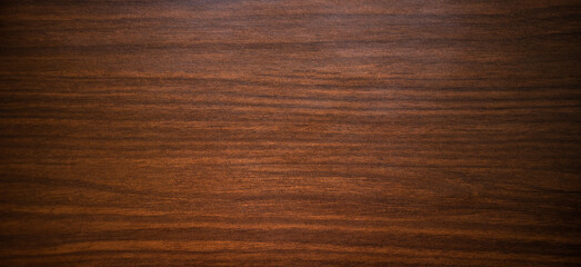 Photo of an antique mahogany texture with black horizontal Art Nouveau stripes