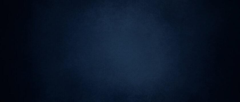 dark blue background texture with black vignette in old vintage textured border design, dark elegant teal color wall with light spotlight center
