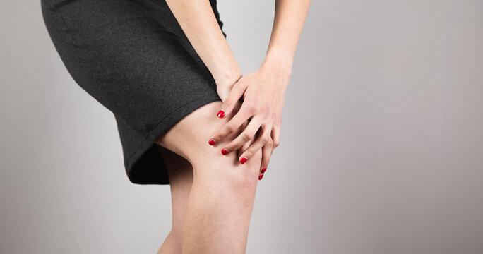 woman hand in ache knee