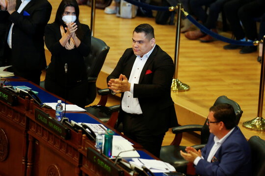Representative Caleb Navarro of the Nuevas Ideas party applauds after voting to approve a loan to finance government programs during a session of The Salvadoran Congress, in San Salvador