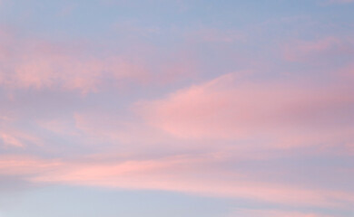 Beautiful image of natural pastel colorful of blue sky and violet clouds in the evening in spring season.   - fototapety na wymiar