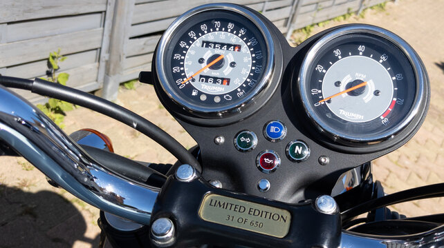 Triumph logo sign on speedometer dashboard bonneville t100 motorcycle 50th anniversary