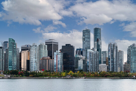 Cityscape of Crowded business buildings and blue sky on coastline in downtown at Stanley Park, Vancouver