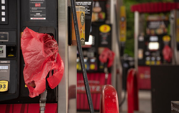 Raleigh, NC United States- 05-12-2021: A red plastic bag covers an empty pump at a gas station. Fuel supply to the Southeast was disrupted due to a cyber attack on the Colonial Pipeline.