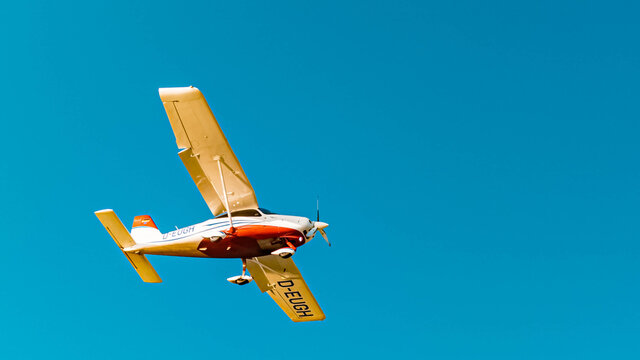 Beautiful sports aircraft approaching Vilshofen airport on a sunny winter day