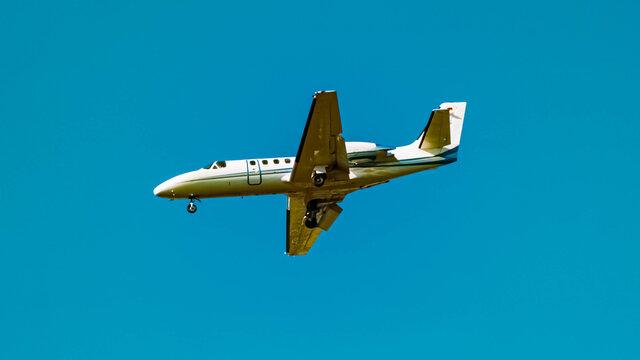 Beautiful small jet airplane approaching munich airport MUC on a sunny winter day