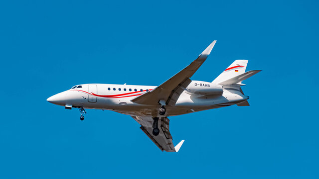 Beautiful small jet airplane (D-BAHB) approaching munich airport MUC on a sunny winter day