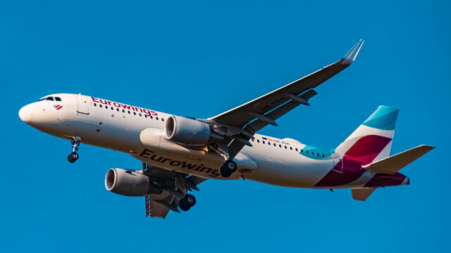 Eurowings Airbus A320 (OE-IQA) approaching munich airport MUC on a sunny winter day