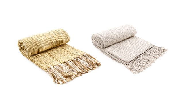 Rolled Two wool beige and yellow blankets isolated on white background