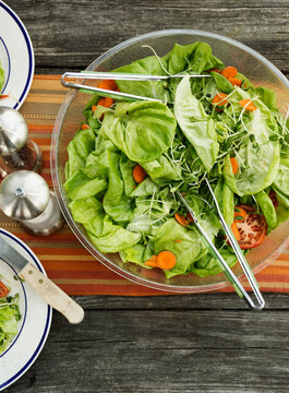 Overhead view of a bowl of salad on table