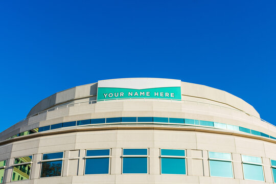 Your Name Here - large banner sign on vacant office building advertising the real estate, property, office for sale, rent or lease - San Jose, California, USA - 2021