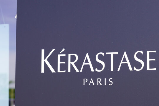 kerastase logo brand and text sign store front of windows hairdresser professional barber shop
