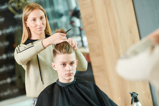 Haircut of young man. Hairdressing at barber shop