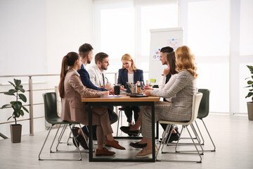 Fototapeta Businesspeople having meeting in office. Management consulting obraz