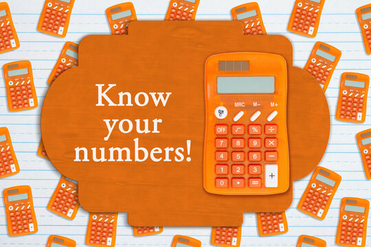 Know your numbers sign on orange calculator on paper