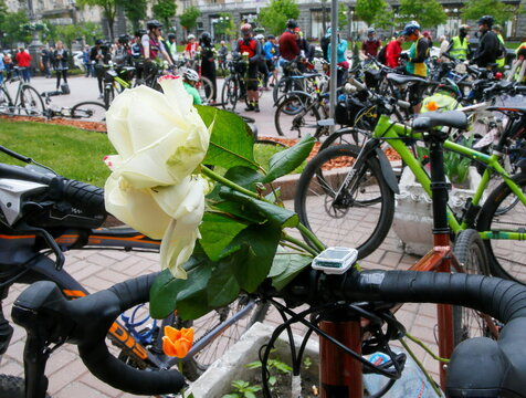 Cyclists take part in a commemoration ceremony for their colleague who was hit by a car, in Kyiv