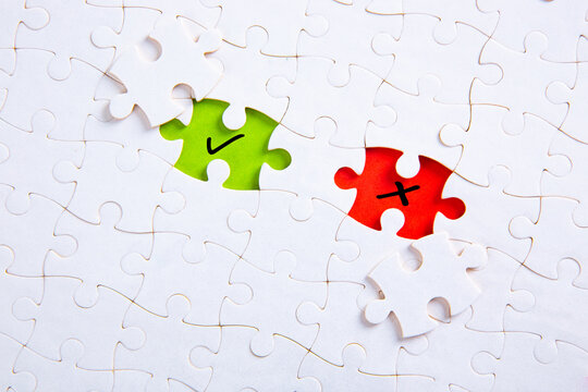 Missing puzzle pieces with check mark and cross symbols. Approve or reject, right or wrong, yes or no.
