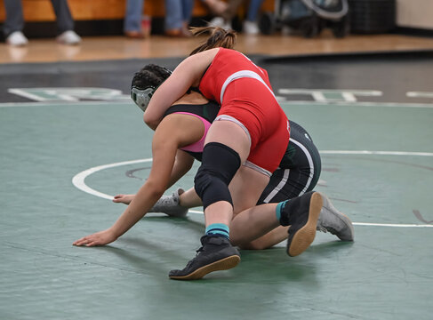Female High School wrestlers competing at a wrestling meet