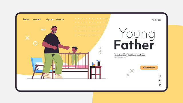 father playing with little son in crib fatherhood parenting concept dad spending time with kid