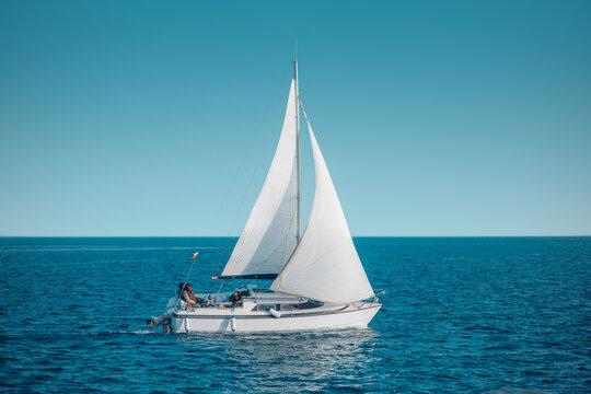Regatta sailing ship yachts with white sails at opened sea