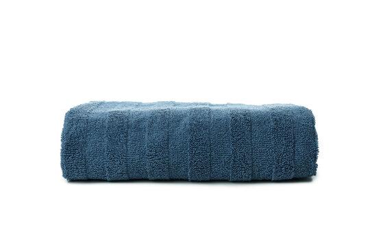 Blue folded towel isolated on white background