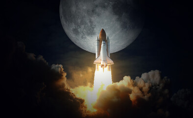 Space Shuttle takes off to the moon. Elements of this image furnished by NASA.