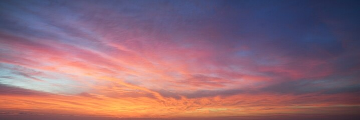Clear blue sky. glowing pink and golden cirrus and cumulus clouds after storm, soft sunlight. Dramatic sunset cloudscape. Meteorology, heaven, peace, graphic resources, picturesque panoramic scenery - fototapety na wymiar