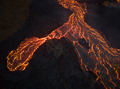 From above the magma of the volcano runs in the form of rivers of lava across the ground in Iceland