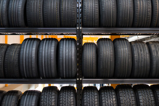 A new tire is placed on the tire storage rack in the car service center. Be prepared for vehicles that need to change tires.