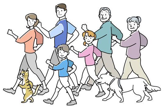 並んでウォーキングする家族-振り向く