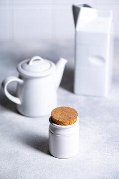 White kitchenware on grey background