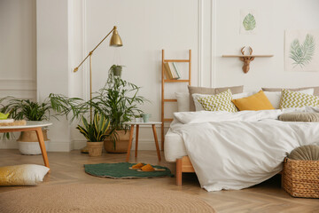 Fototapeta Modern bedroom with beautiful fresh house plants obraz