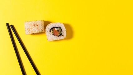 Fototapeta two sushi rolls with copy-space obraz