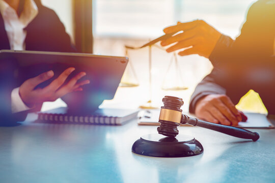 Legal law, advice and justice concept,Business lawyer working about legal legislation in courtroom to help their customer.
